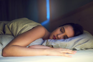 Shot of a young woman sound asleep in her bedroom ac air conditioning sleeping health benefits